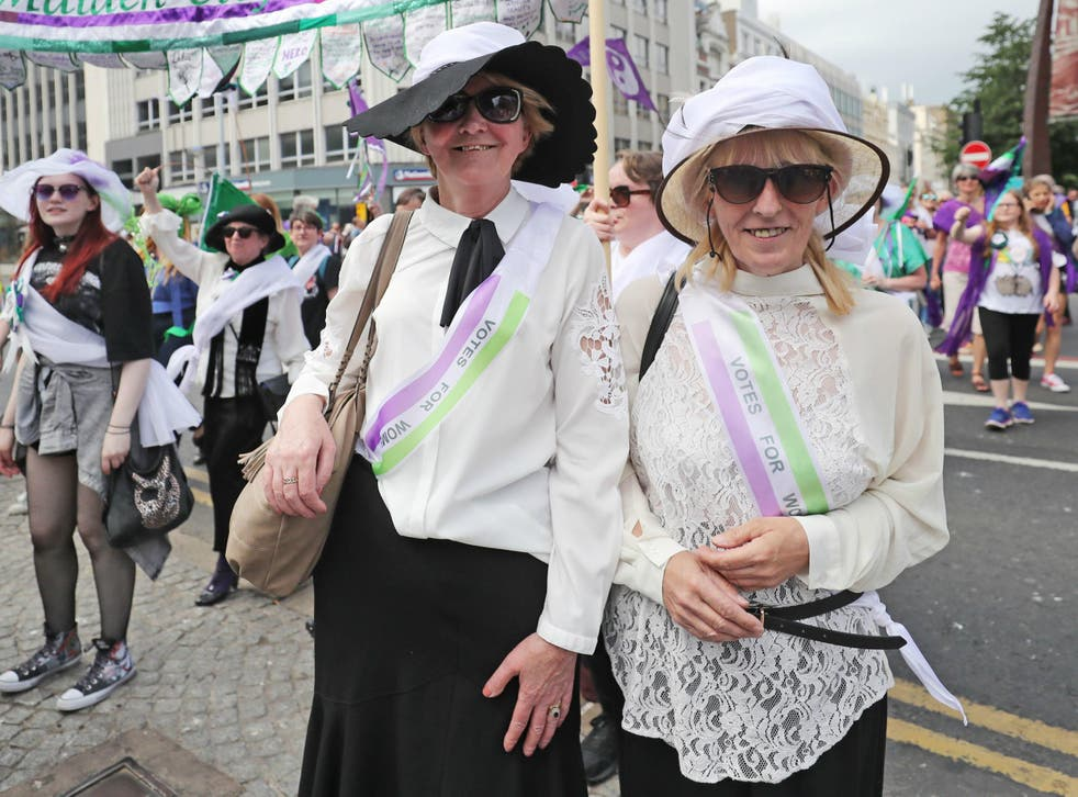 Women dressed as suffragettes take part in the Processions' artwork march, in Belfast, as they mark 100 years since the Representation of the People Act