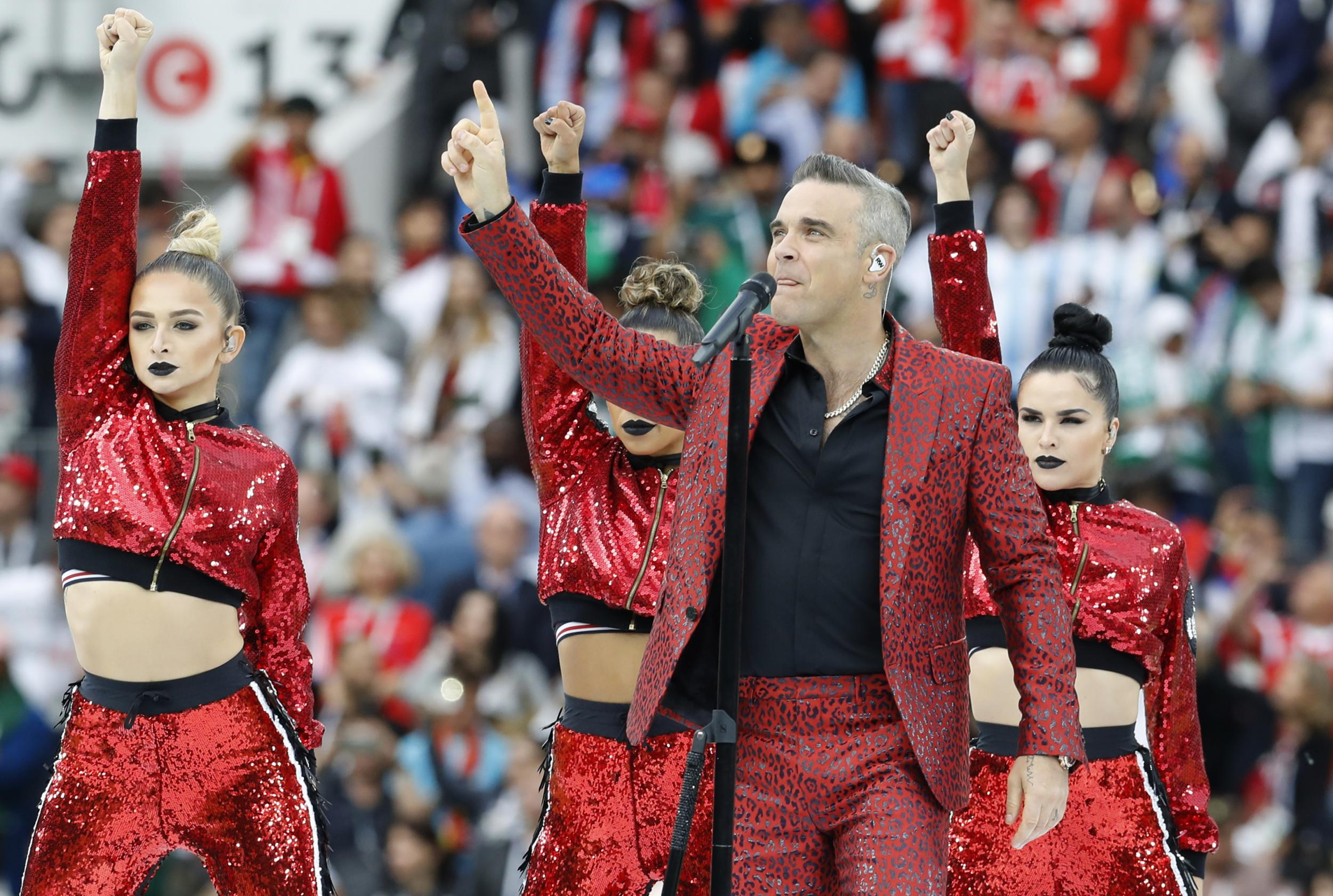 World Cup 2018: Robbie Williams may have broken Russian law by kicking off tournament by giving middle finger to camera