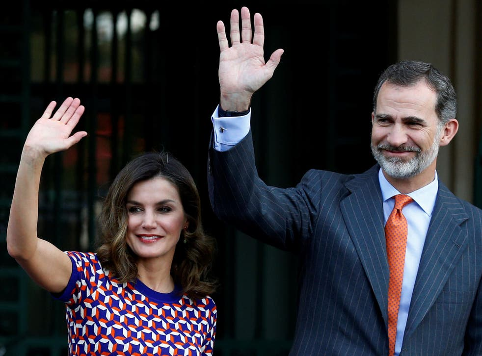 Spain's King Felipe VI and Queen Letizia wave as they arrive at the Cabildo in New Orleans, Louisiana, on 15 June 2018