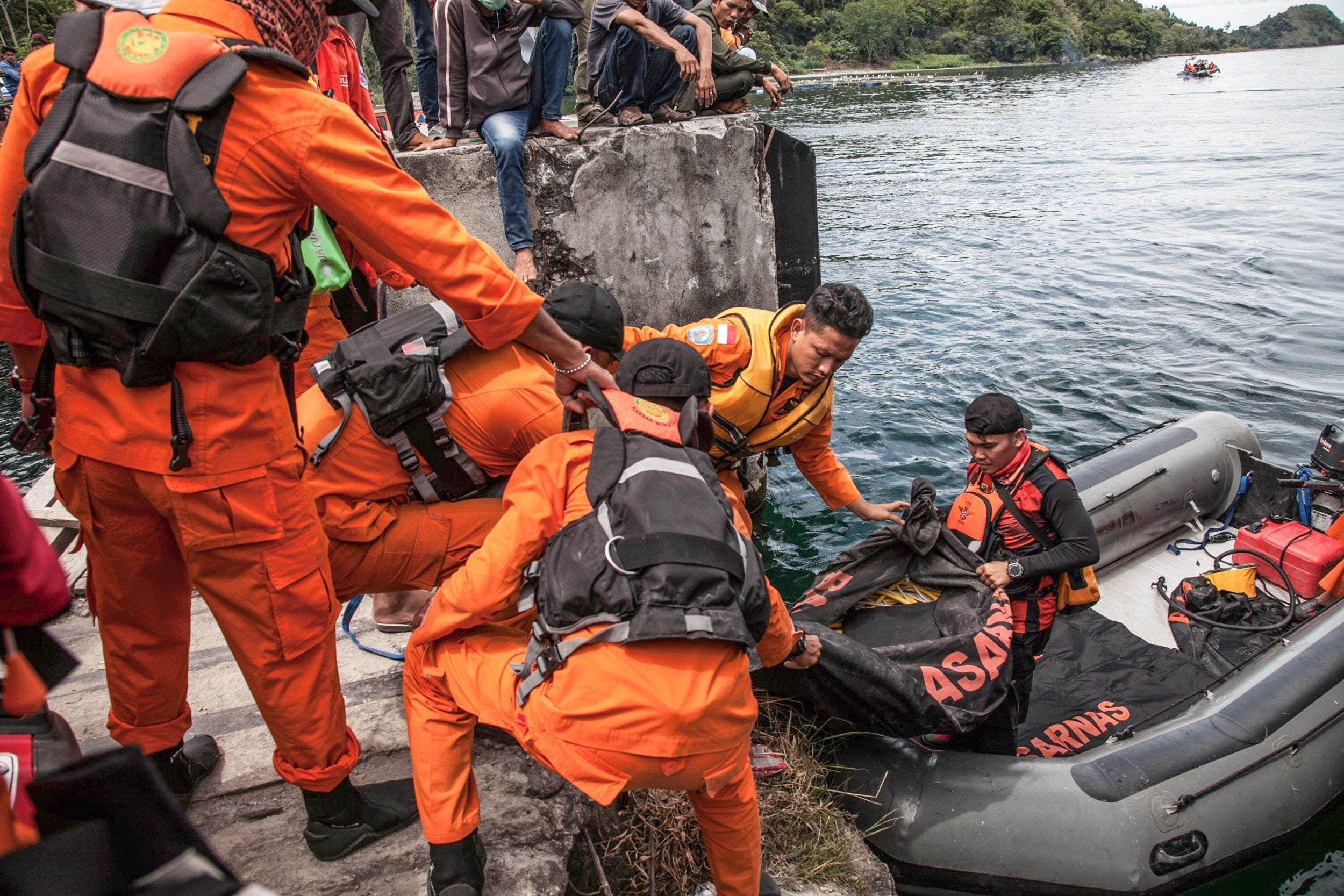 Indonesia ferry disaster: Toll of missing soars to 180 as drone joins search for boat wreckage