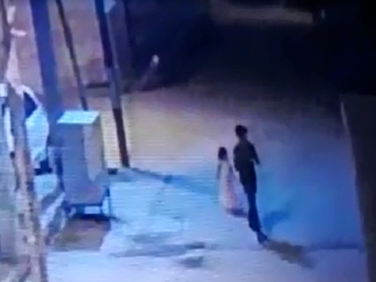 Girl aged six seen on CCTV being led away to her rape and murder in