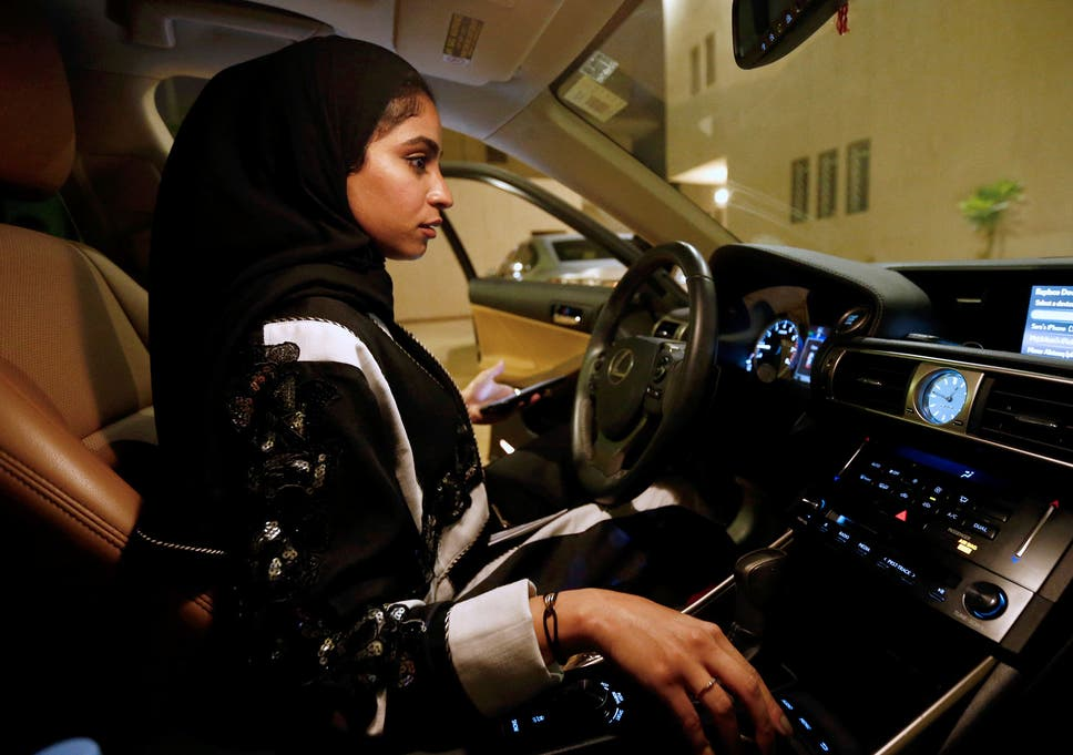Majdooleen, who is among the first Saudi women allowed to drive in Saudi Arabia gets ready before she starts to drive her car in her neighborhood in Riyadh on 23 June
