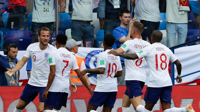 Harry Kane celebrates with team mates after scoring England's second