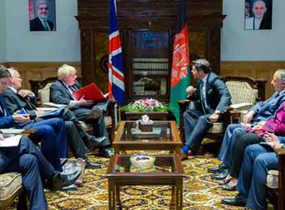 Boris Johnson meeting his Afghan counterpart in Kabul on the day MPs vote on Heathrow expansion