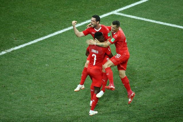 Blerim Dzemaili of Switzerland celebrates with teammates