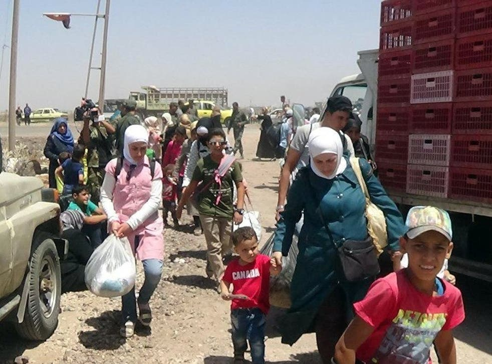 People flee the violence with their belongings in the Deraa countryside