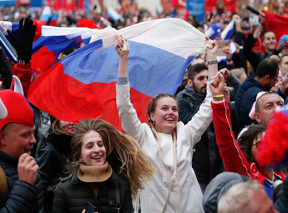 Party time: Russian fans celebrate their victory over Spain