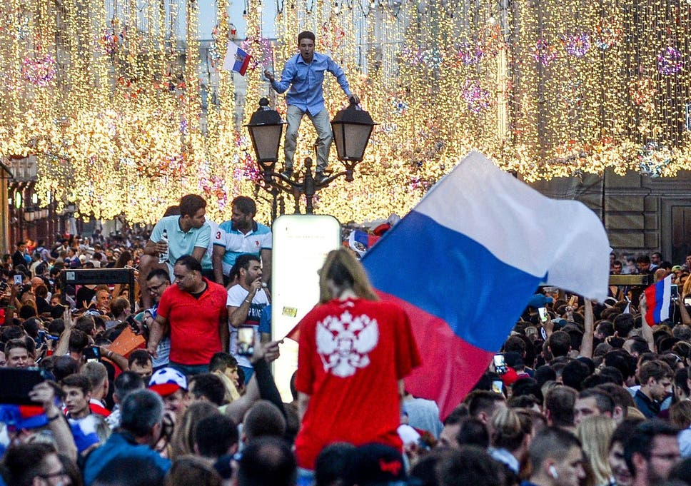 28c4d855a Fans celebrate in Moscow after the host nation sent Spain out of the World  Cup