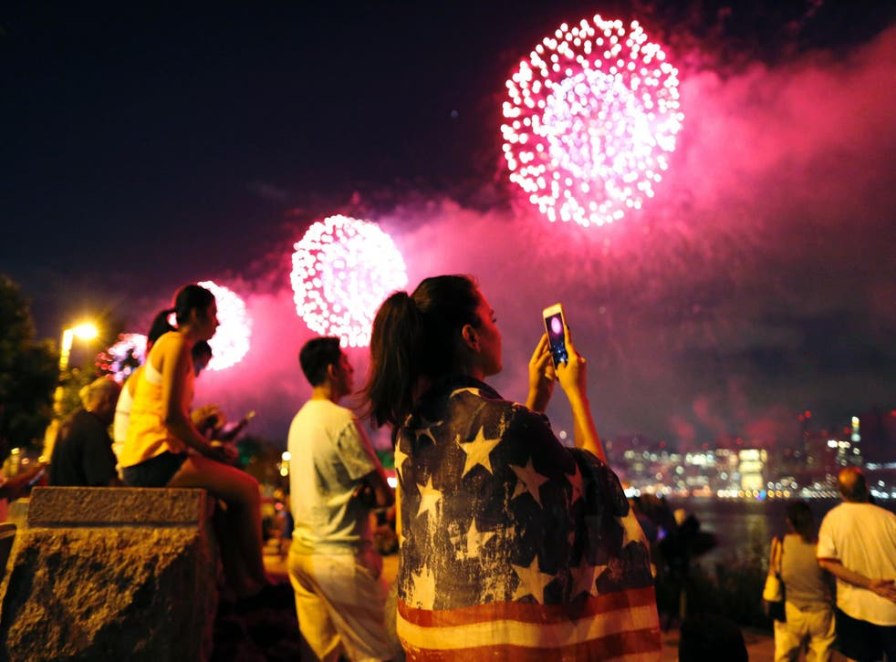 People watch a fireworks show in Queens, New York