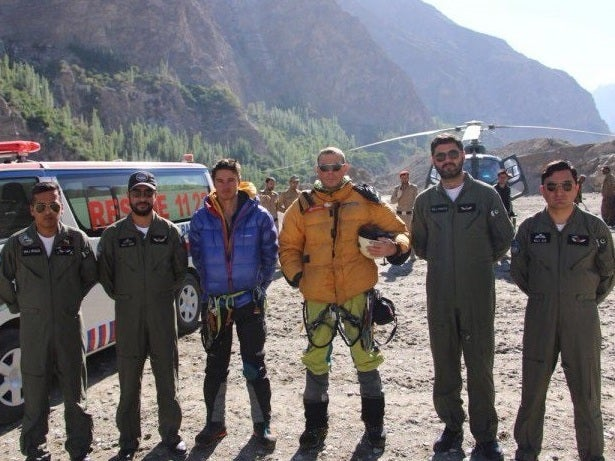 British climbers rescued by helicopter from Pakistani mountain after Austrian counterpart dies