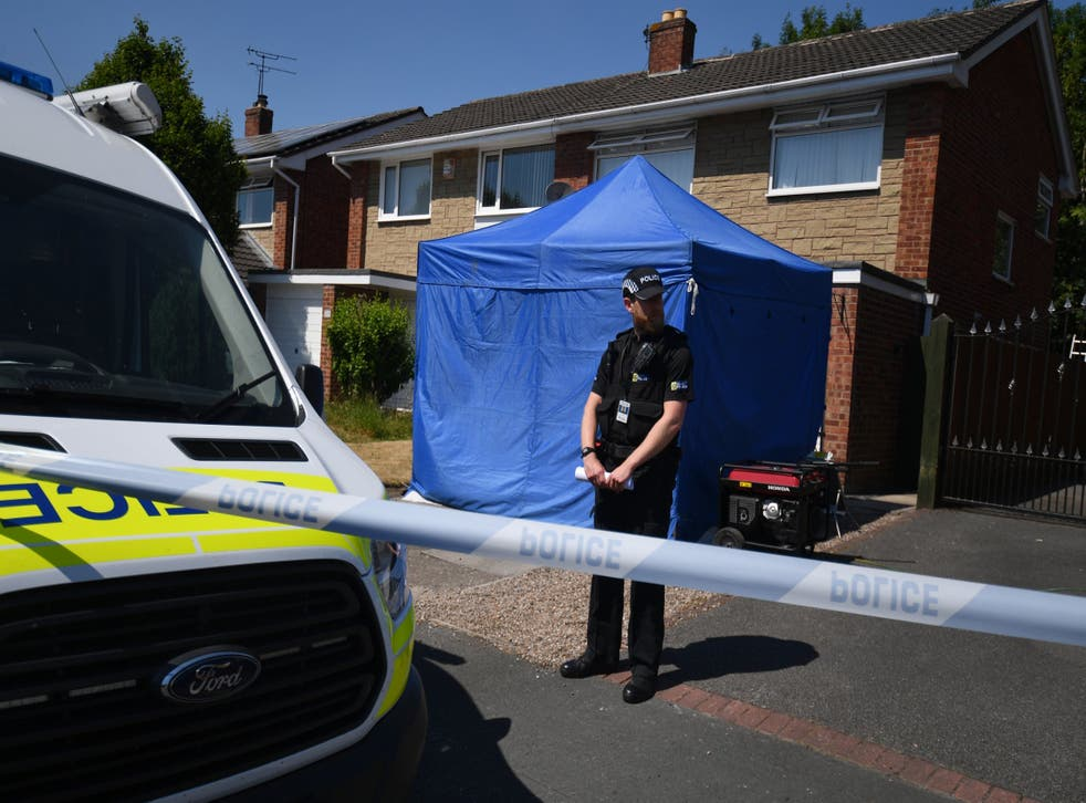A police officer stands outside a home Chester after a healthcare professional working at the Countess of Chester Hospital was arrested on suspicion of murdering eight babies