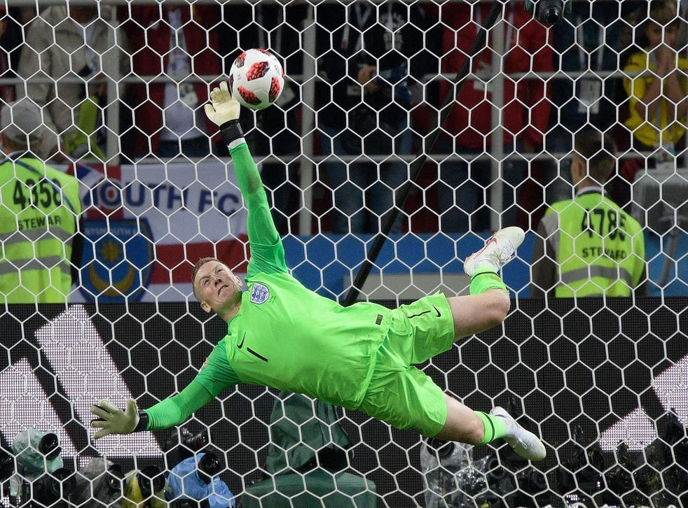 England's goalkeeper Jordan Pickford stops Colombia's forward Carlos Bacca's shot during the penalty shootout at the end of the Russia 2018 World Cup round of 16 football match between Colombia and England at the Spartak Stadium in Moscow on July 3, 2018