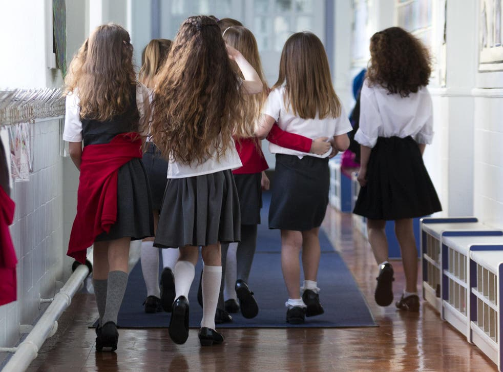 A mother is is planning to take legal action against the government's 'discriminatory' uniform policy