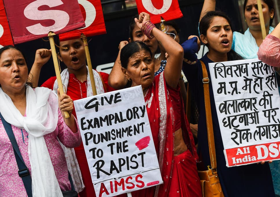 Indian women protest against the rape of an eight year old in in New Delhi