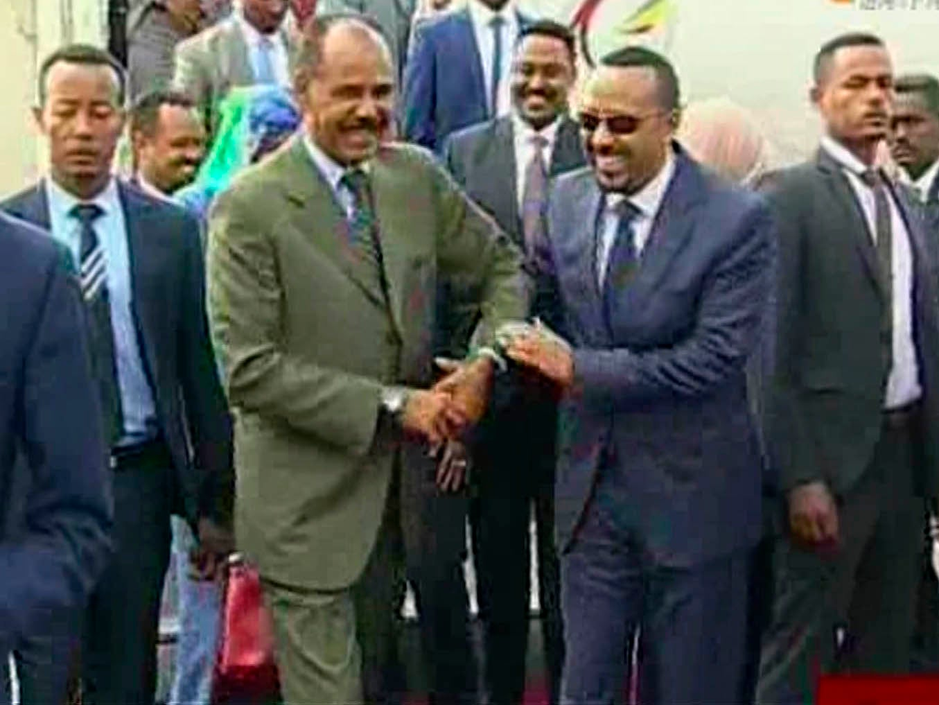 Ethiopian and Eritrean leaders share hugs and laughter in momentous first meeting for decades