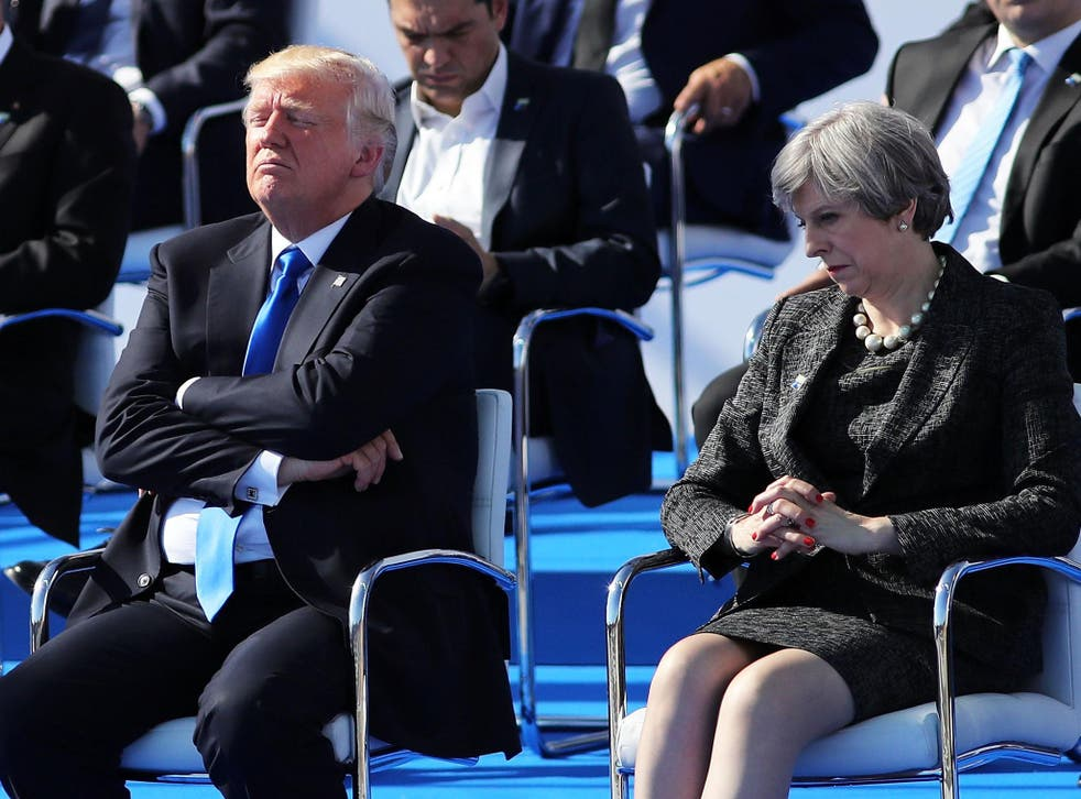 Climate scientists have urged Theresa May to challenge the US president on his climate 'inaction'