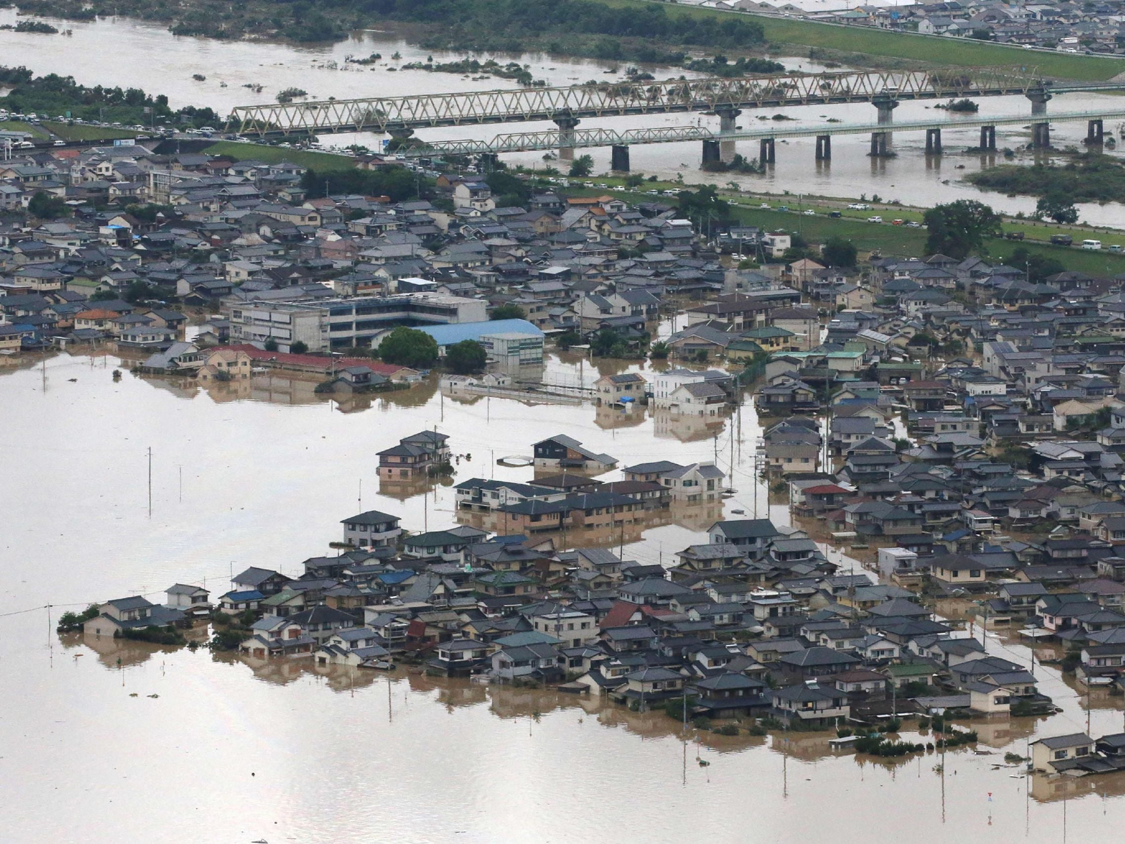 Japan floods: At least 155 killed in worst weather disaster in 36 years