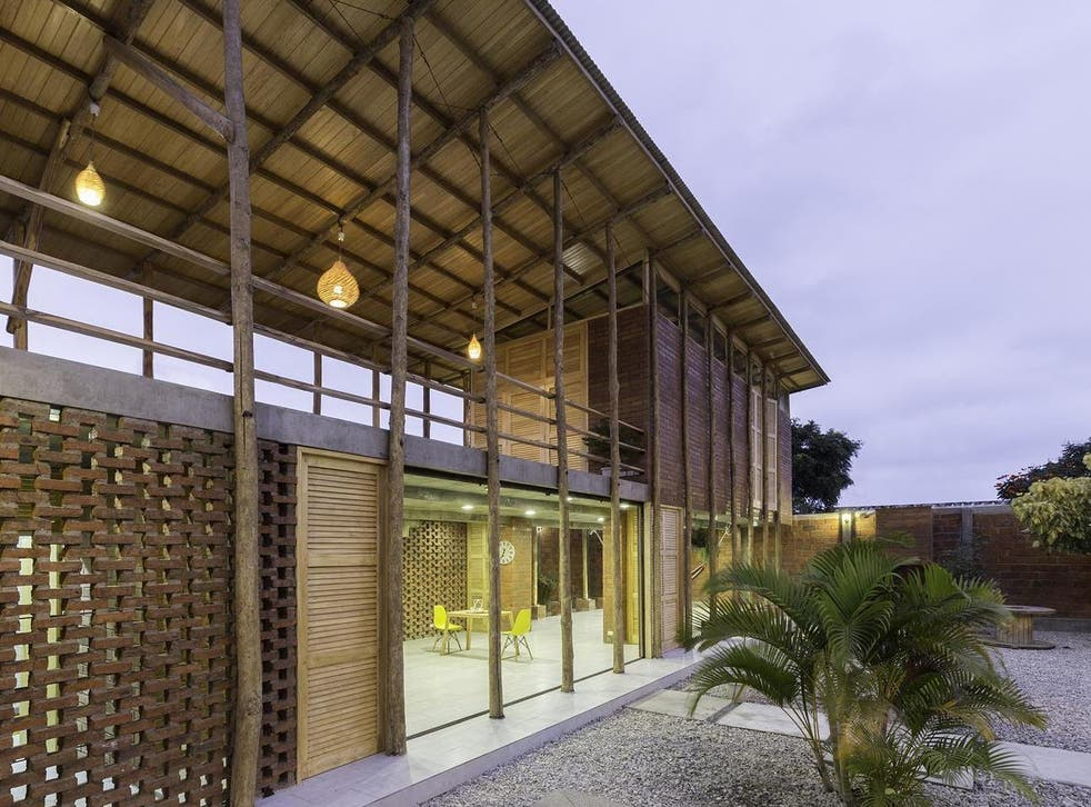 The architects chose not to use any glass in the home, instead incorporating traditional elements such as wooden slat walls that allow ventilation