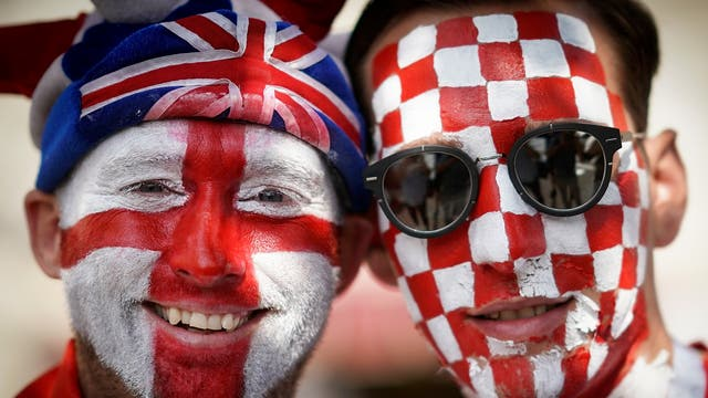 England and Croatian fans pose in Red Square ahead of the match