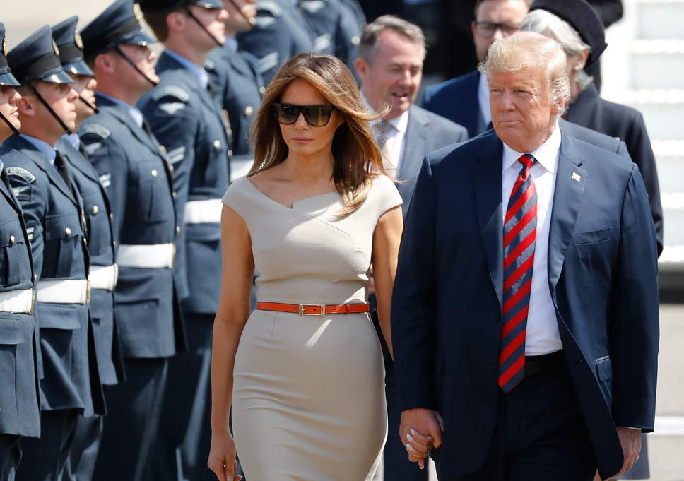 President Trump and First Lady Melania Trump are greeted by an honour guard of Royal Air Force presonnel after disembarking Air Force One at Stansted Airport