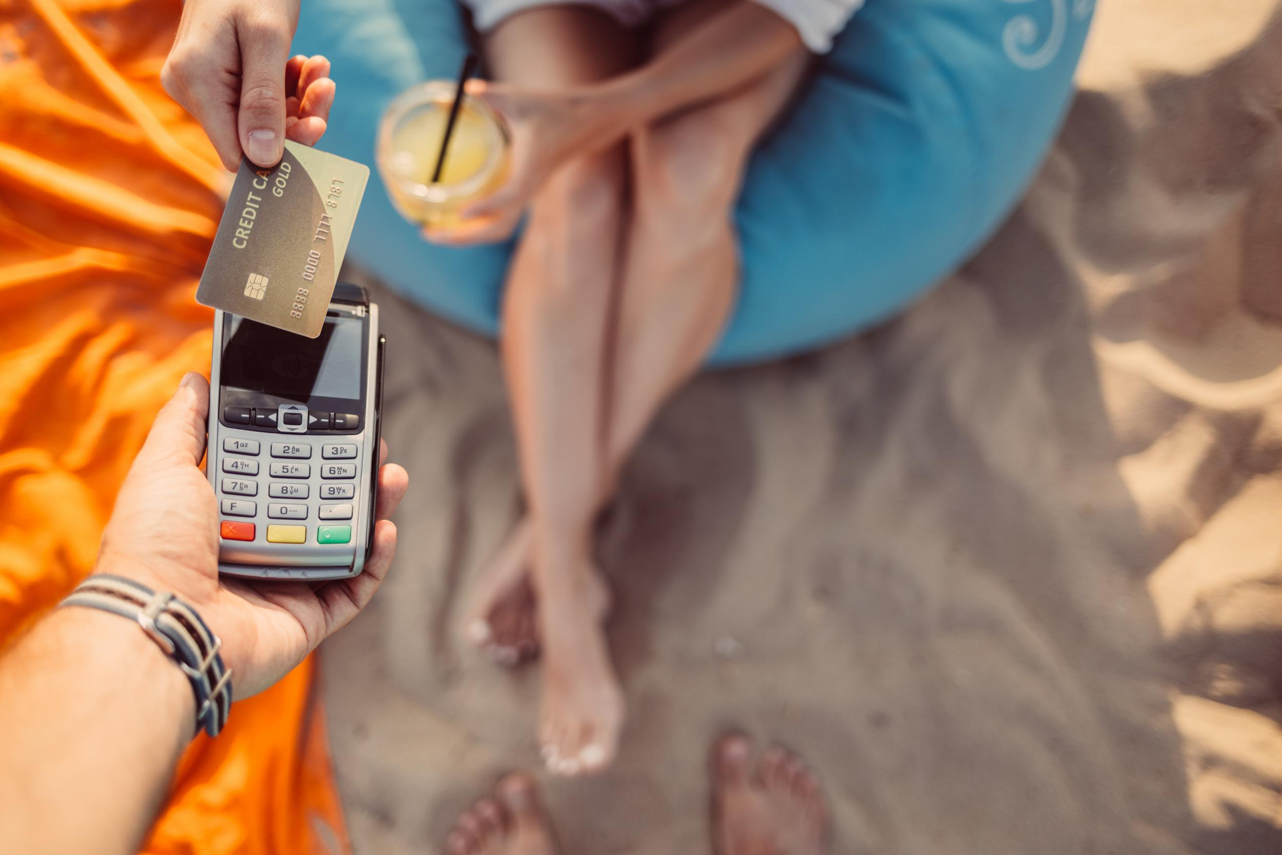 Why you should pay in local currency when using cards or ATMs abroad