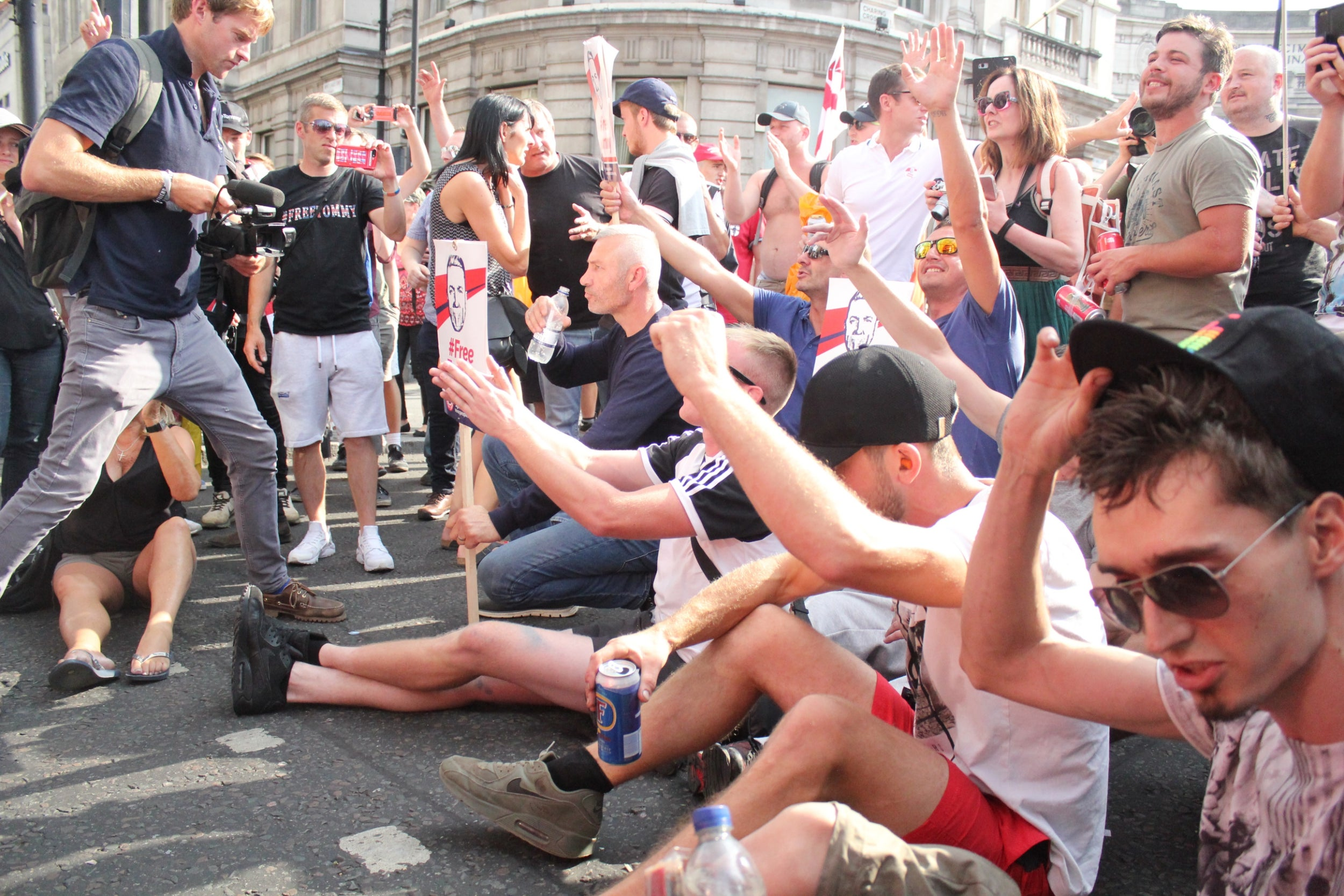 Angela Sun Topless tommy robinson march: protesters blockade bus driven