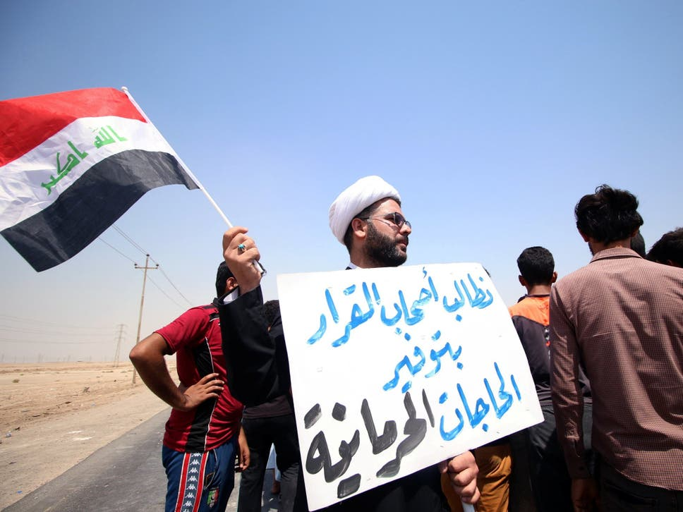 The major uprising in basra and southern iraq is what the world a protester holds a sign that reads we ask the decisionmakers to provide the things publicscrutiny Gallery