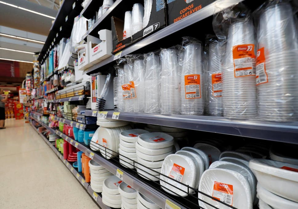 Plastic Cups And Other Products Are Seen On Sale In A Supermarket