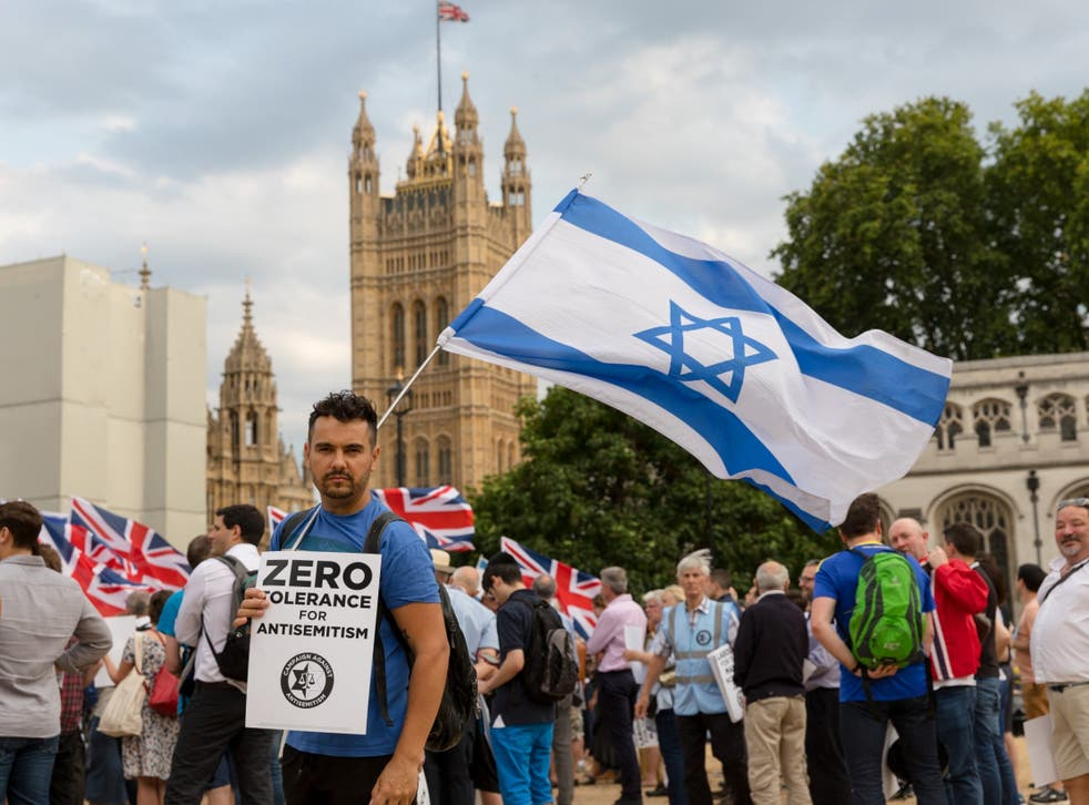 Protesters demonstrating outside parliament over alleged antisemitism in the Labour Party