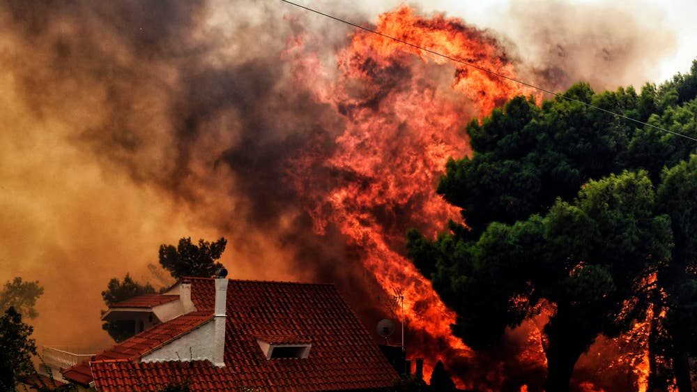 The fires tearing through Greece are not an act of God, but