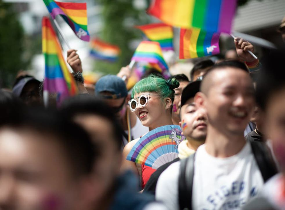 People attend the annual Tokyo Rainbow Parade in Tokyo, 6 May 2018