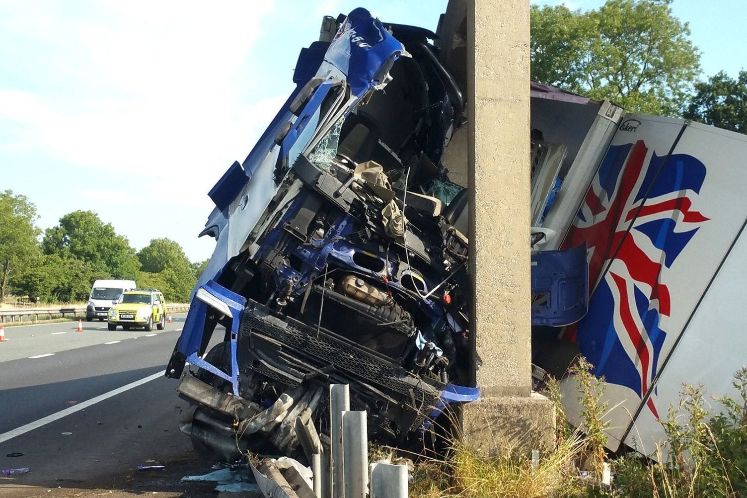 m6 crash lorry driver smashes into motorway bridge the independent