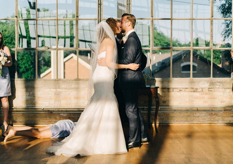 fainting bridesmaid leads to one of the most unique wedding photos