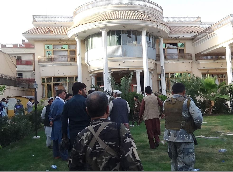 Afghan security forces inspect the damage after the attack on the midwife training centre