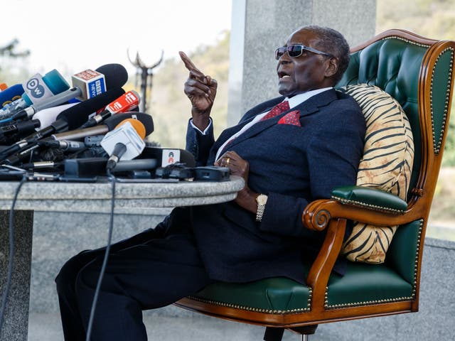 Mugabe speaks during a press conference held at his 'Blue Roof' residence in Harare