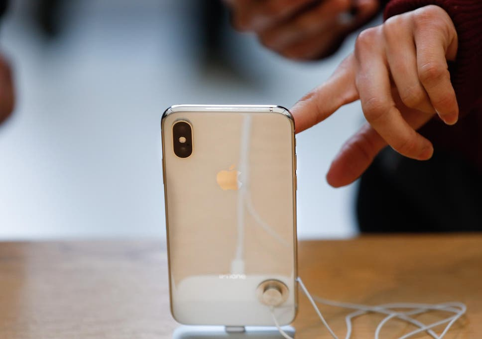 A customer touches the screen of the new iPhone X at the Apple Store Union Square on November 3, 2017, in San Francisco, California