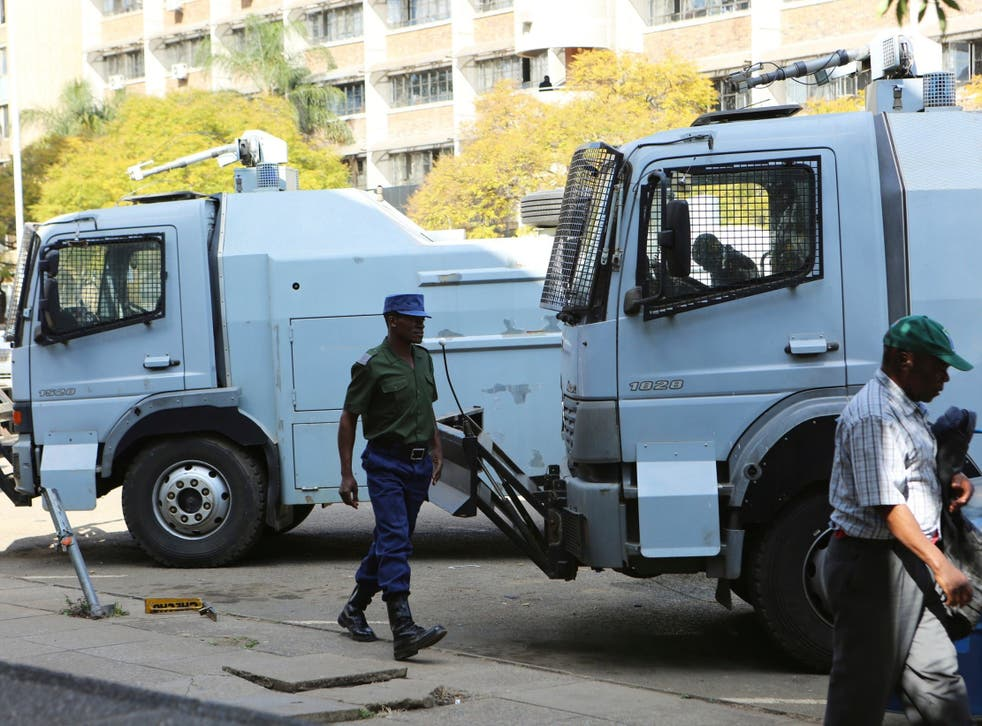 Police water cannons are seen in the capital, Harare, Zimbabwe where tensions are high following the general election.