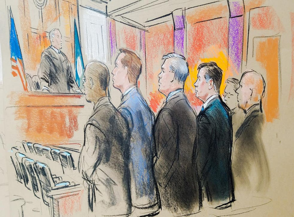 Former Trump campaign manager Paul Manafort stands with his attorneys before U.S. District Judge TS Ellis in a court room sketch, on the opening day of his trial