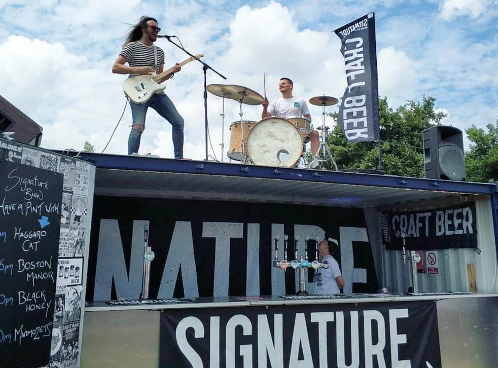 Signature Brew collaborates with bands in its mission to get craft beer into music venues: Haggard Cat play a gig atop its bar at 2000Trees festival