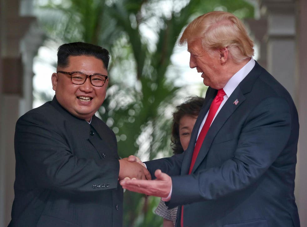 North Korean leader Kim Jong-un shakes hands with US President Donald Trump during their historic US-DPRK summit