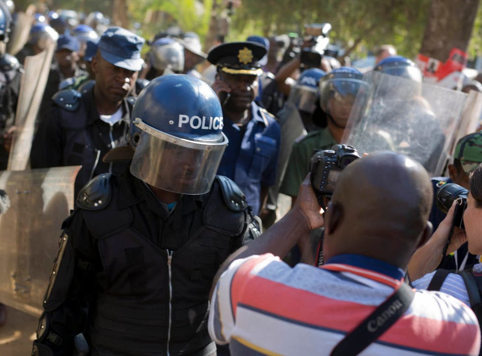 Riot police enter the Bronte hotel in Harare, where a press conference by Chamisa was scheduled to take place