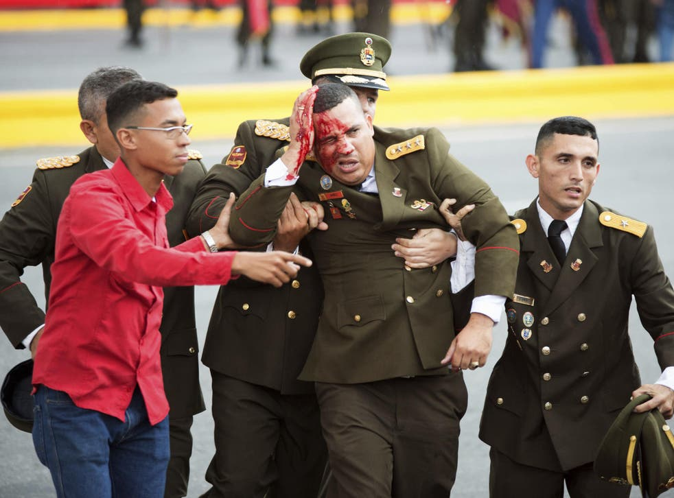 A soldier bleeds from the head following theincident in Caracas onSaturday