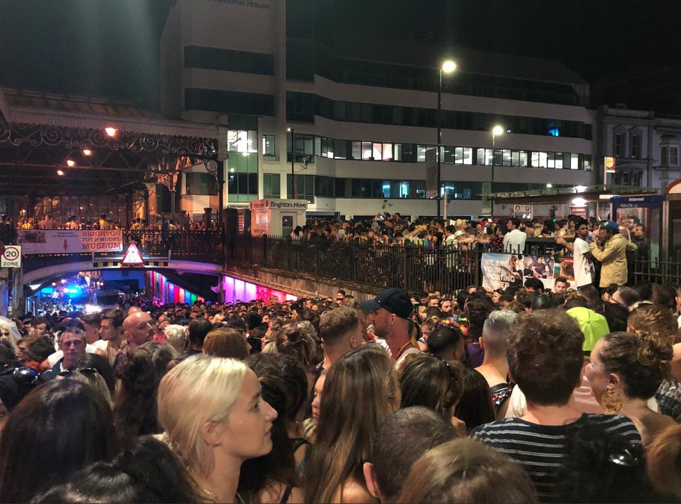 Partygoers wait outside Brighton train station.