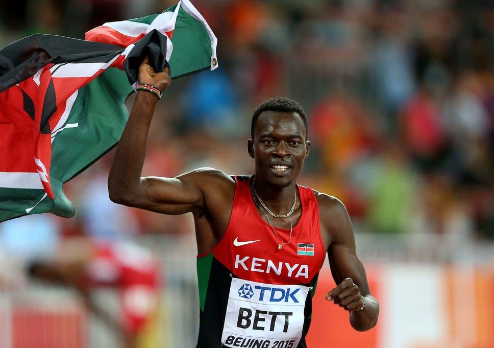 Nicholas Kiplagat Bett waving Kenyan flag