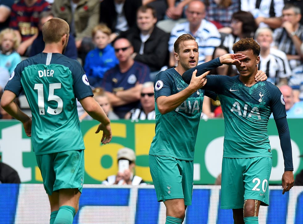 Dele Alli is congratulated after his winning goal