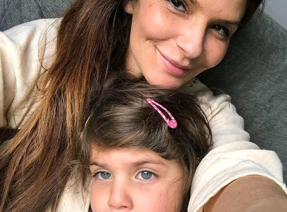 Ellie Holman and her daughter were detained in Dubai after the dentist drank a glass of wine on a flight