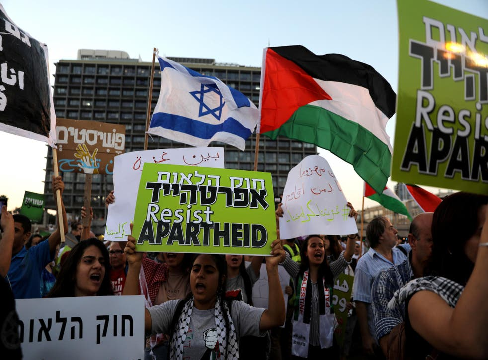 Israeli Arabs and their supporters take part in a rally to protest against Jewish nation state law in Rabin Square in Tel Aviv on 11 August 2018