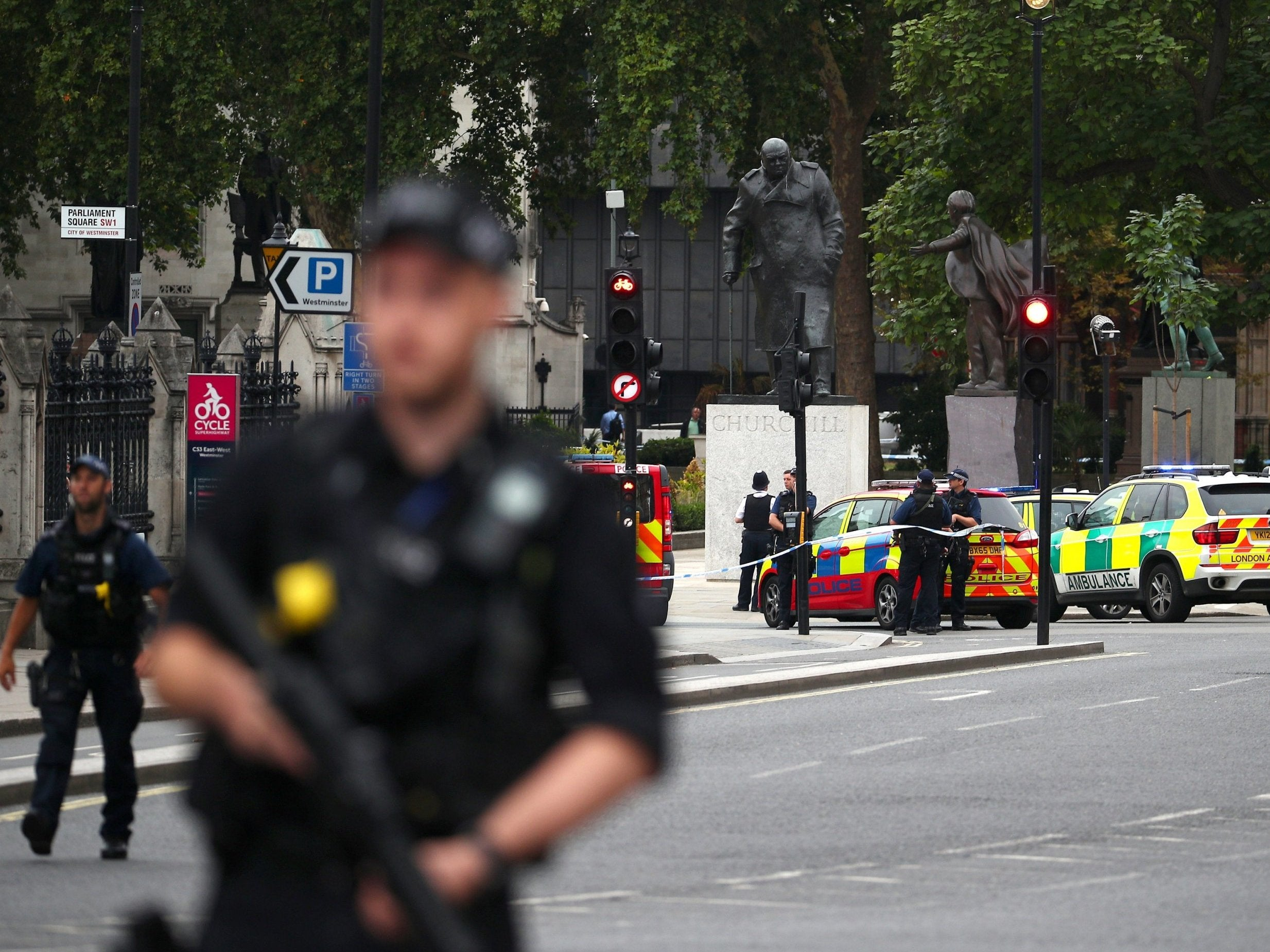parliament car crash - as it happened: police search three