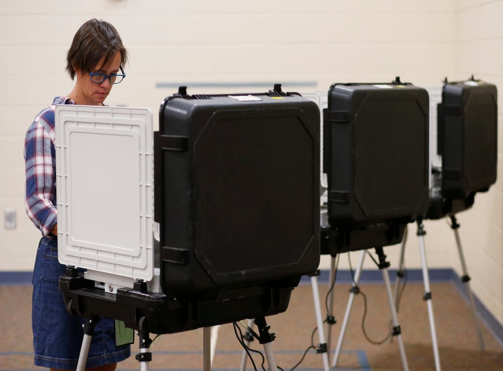 A voter casts their vote during an American primary election