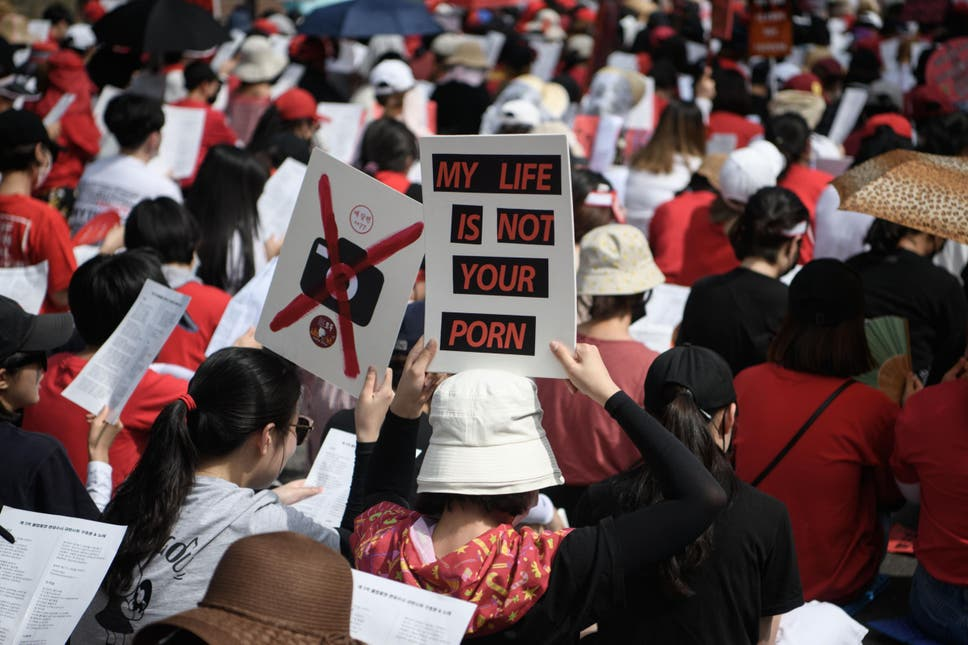 Female protesters call for South Korea's government to crack down on widespread spycam porn crimes at a rally in Seoul on 7 July 2018
